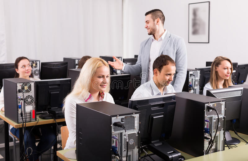 Employees working at office stock photos