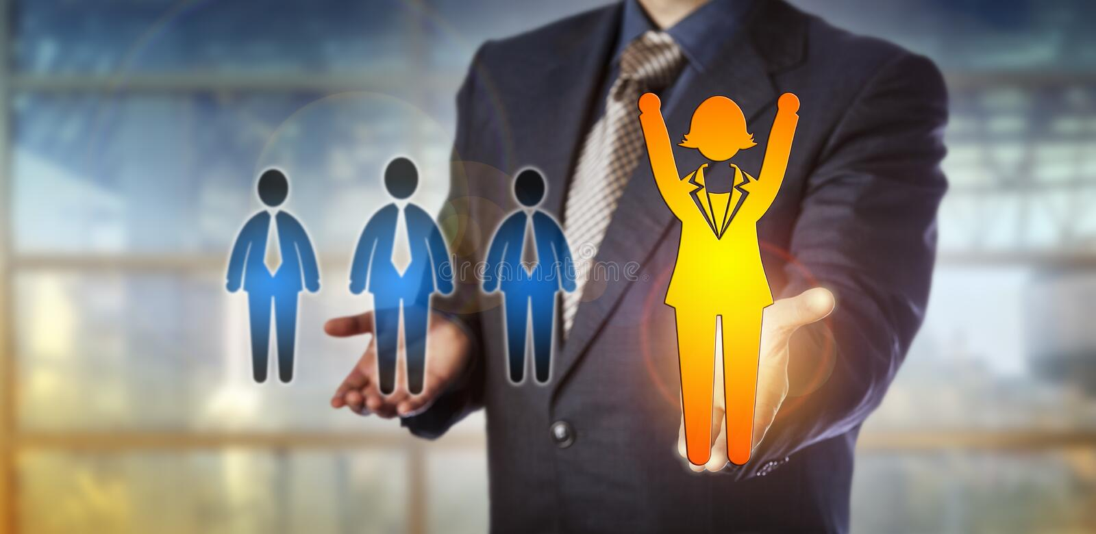 Employer Championing A Winning Female Employee. Unrecognizable employer championing a winning female employee over a group of three male candidates. Human royalty free stock photography