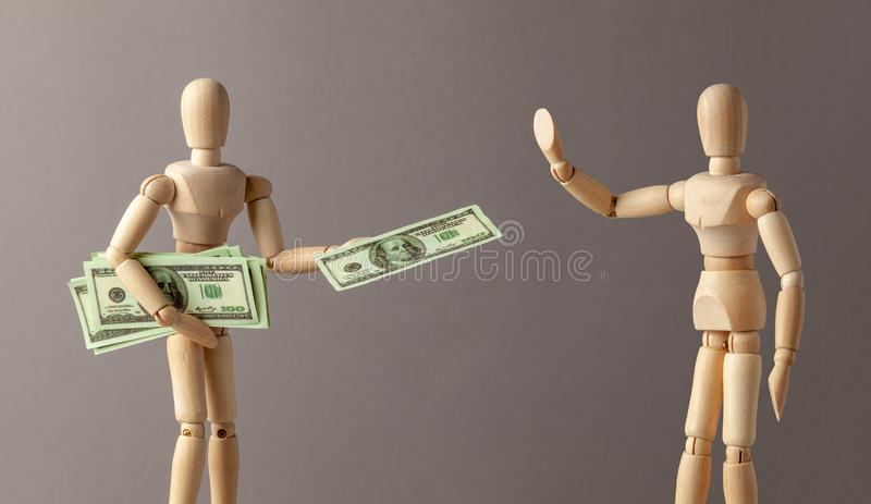 The employer issues a cash salary. Businessman to share profits or bribe. A man holds a lot of money in cash and gives one bill. Man refuses to take bribe stock images