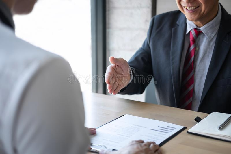 Employer or recruiter holding reading a resume during about colloquy his profile of candidate, employer in suit is conducting a stock images