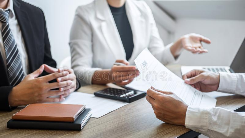 Employer or recruiter holding reading a resume with talking during about his profile of candidate, employer in suit is conducting stock photos