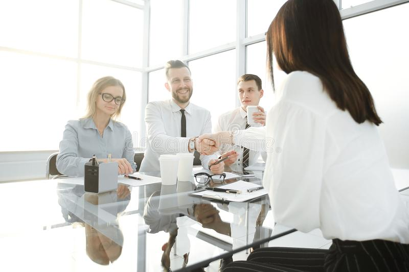 Employer shakes hands with the candidate for the vacant position royalty free stock photography