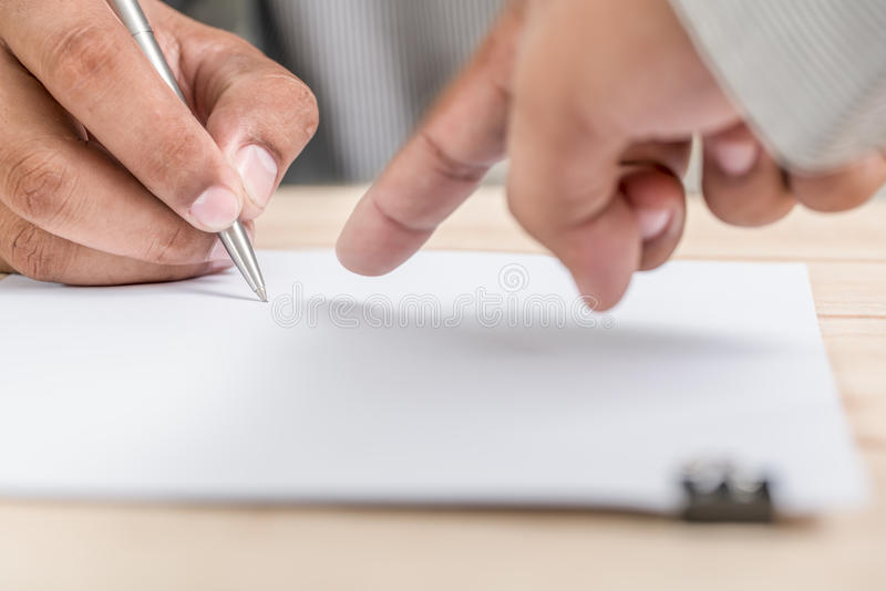 The employer shows that the employee will be written and signed. stock image