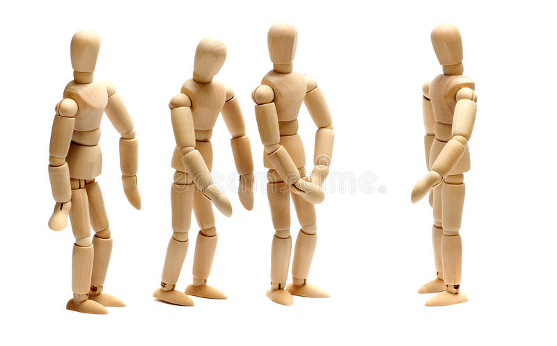 Employer and team of wooden dolls. On white royalty free stock photos