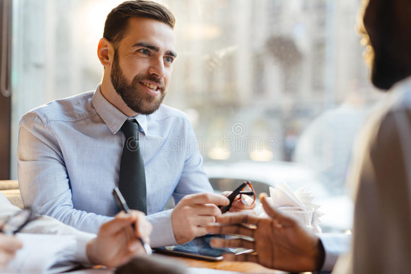 Employer at work. Confident employer talking to candidate for vacancy royalty free stock images