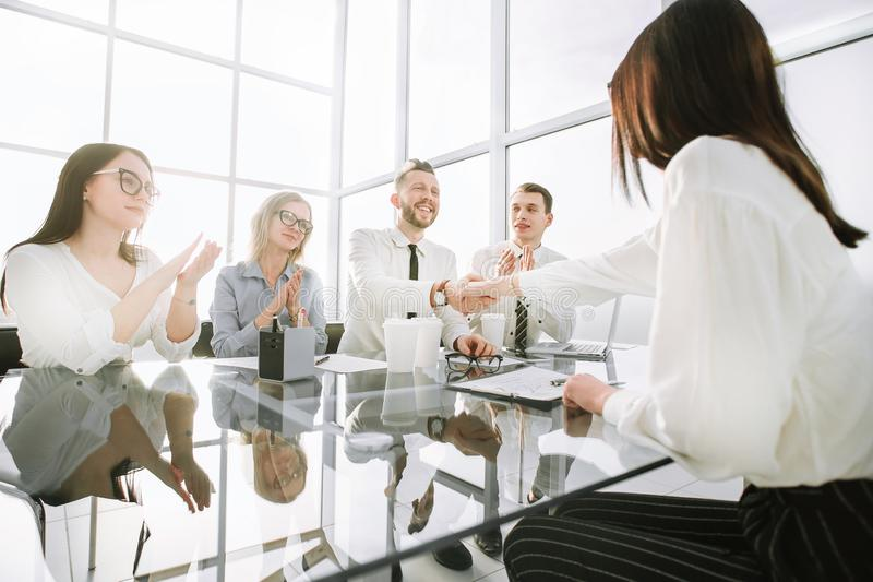 Employers congratulate the employee on his promotion royalty free stock image