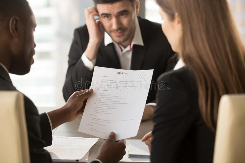 Employers considering bad resume, unhired worried applicant wait. Employers or recruiters holding reviewing bad poor cv of unemployed worried nervous applicant royalty free stock photo