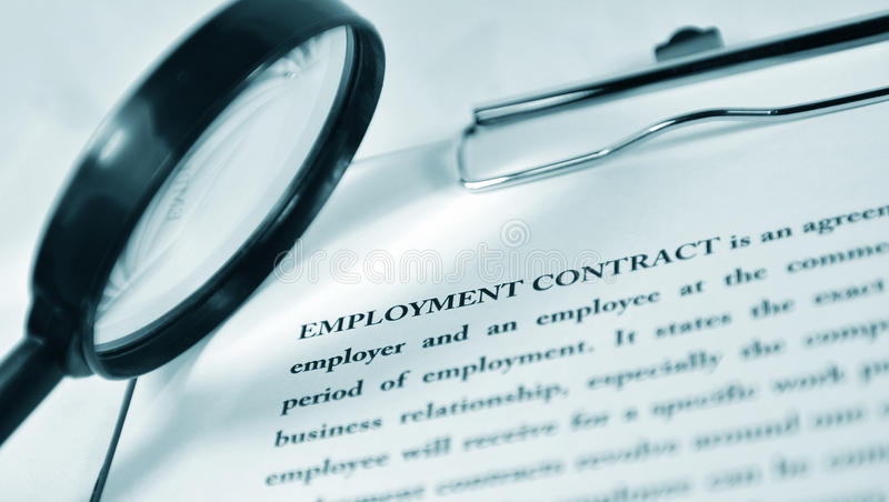 Employment contract. Under the magnifying glass royalty free stock images
