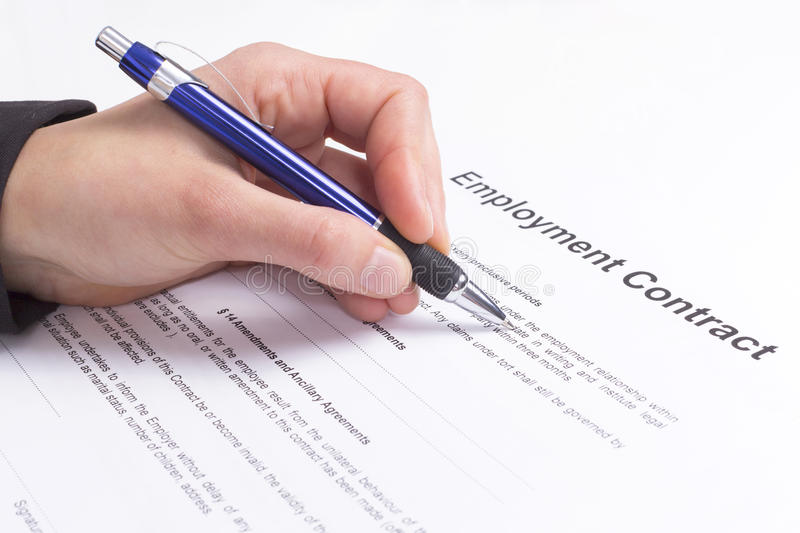Employment contract. Hand with pen and employment contract royalty free stock images