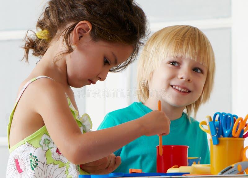 Employment in a kindergarten stock image