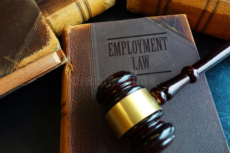 Employment Law book. With legal gavel stock photography