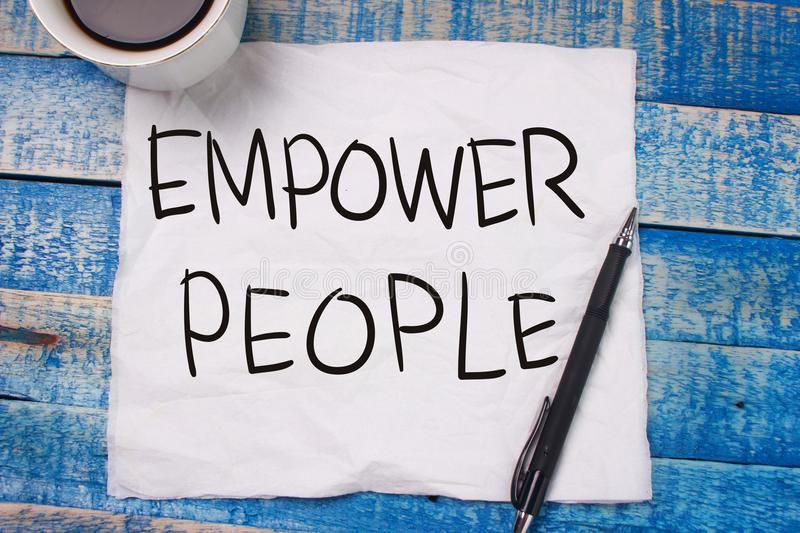Empower People. Motivational Text stock photo