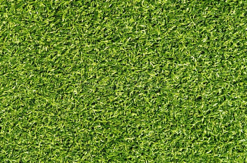Empréstimo decorativo da grama da cor verde para o esporte e o lazer foto de stock