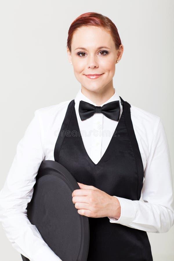 Empregada de mesa com bandeja vazia imagem de stock