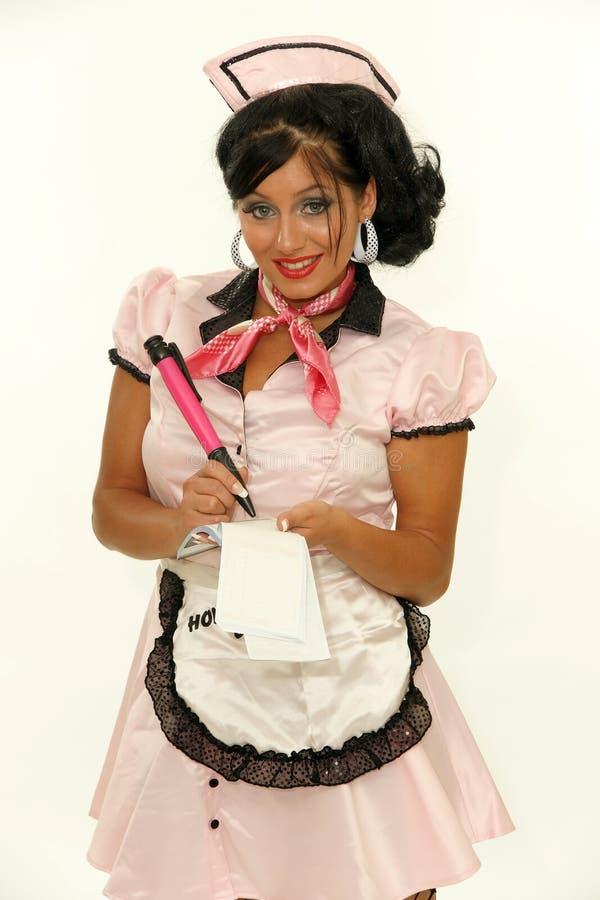 Empregada de mesa do café no uniforme retro fotografia de stock