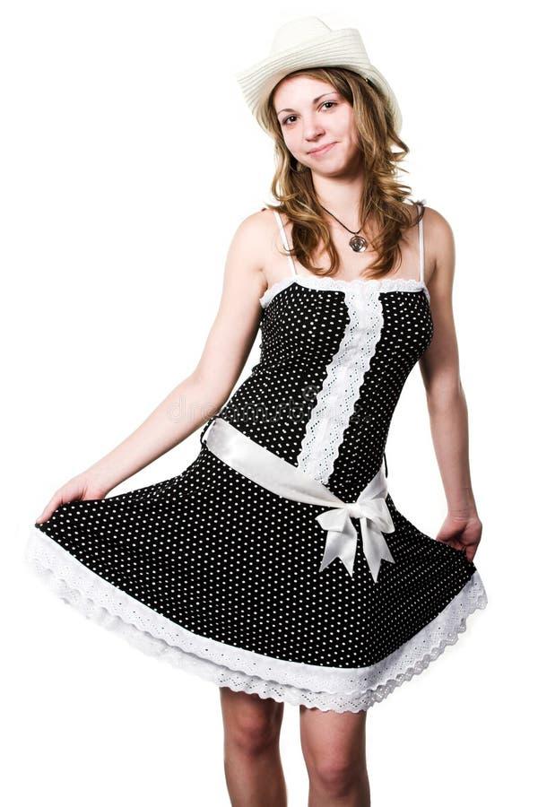 Empregada de mesa no vestido e em stetson manchados imagens de stock