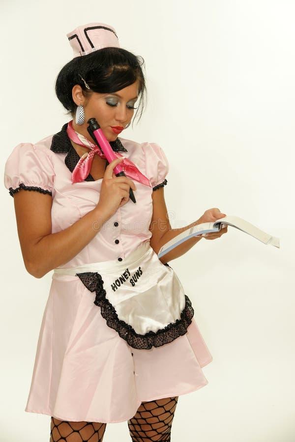 Empregada de mesa que toma o pedido imagem de stock