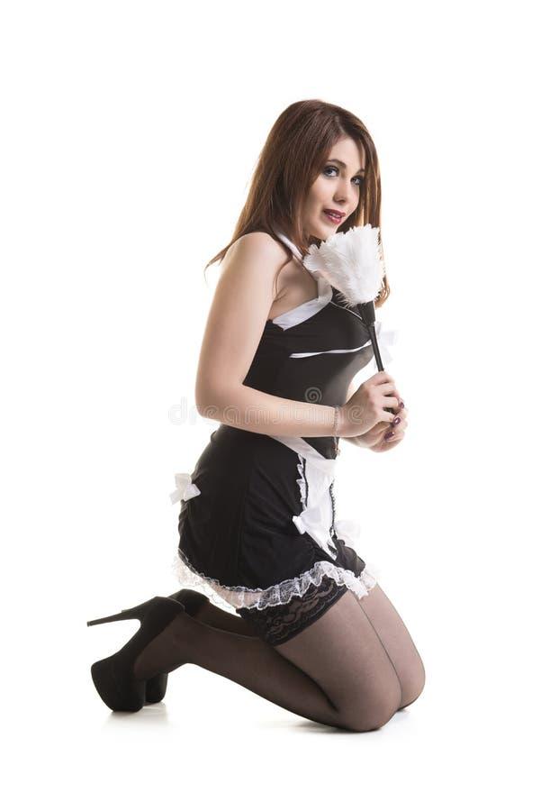 Empregada doméstica atrativa nova fotografia de stock