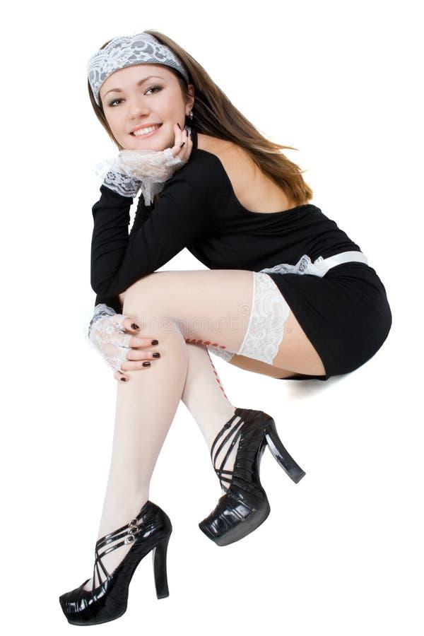 Empregada doméstica nova 'sexy' de sorriso fotografia de stock