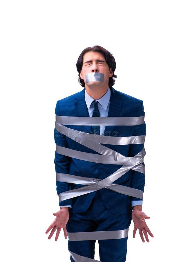 Empregado amarrado com a fita na boca isolada no branco imagem de stock