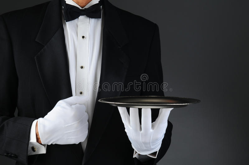 Empregado de mesa com bandeja de prata imagem de stock