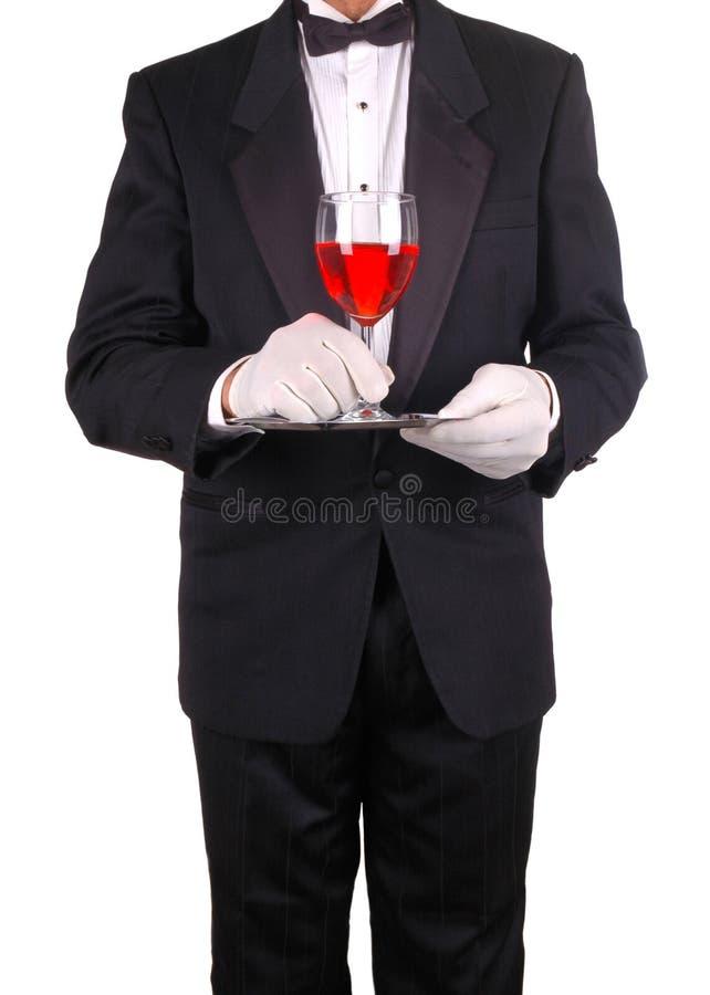 Empregado de mesa com bandeja e vinho foto de stock