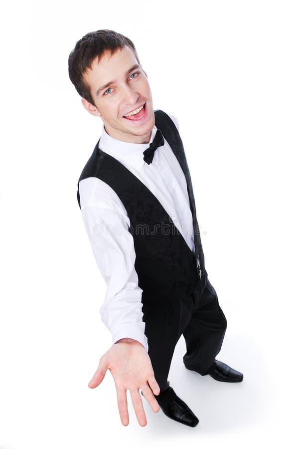 Empregado de mesa que mostra algo fotos de stock
