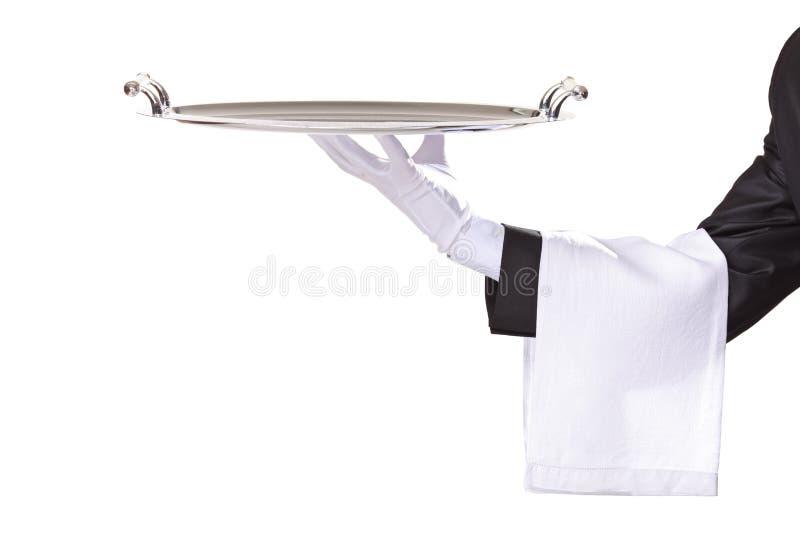 Empregado de mesa que prende uma bandeja de prata fotos de stock