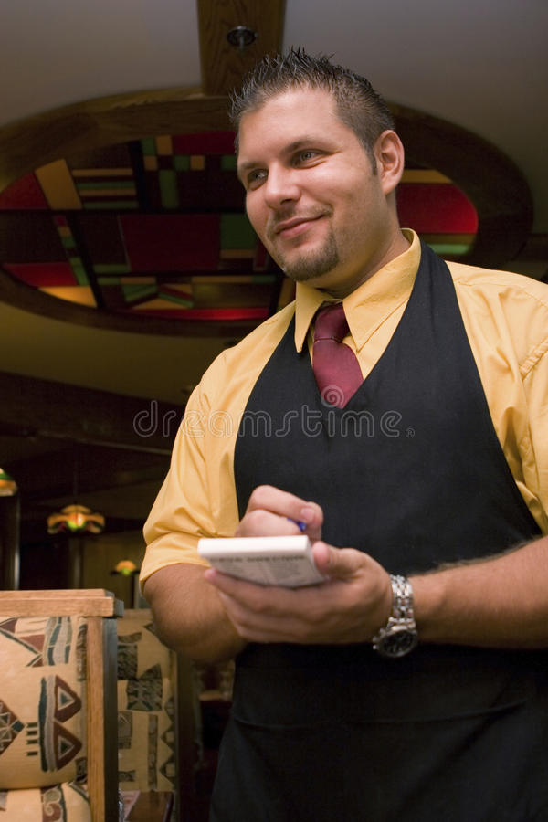 Empregado de mesa que toma o pedido fotografia de stock