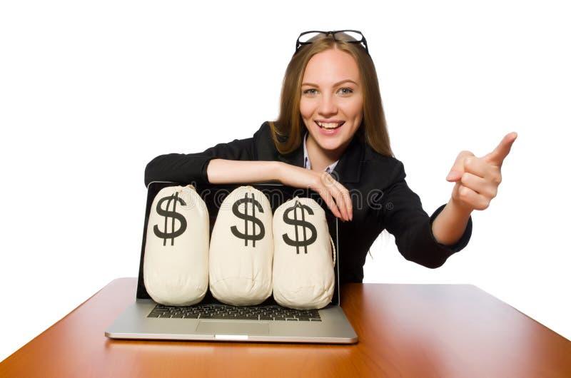 Empregado do sexo feminino com os sacos do dinheiro em sua tabela foto de stock royalty free