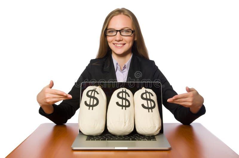 Empregado do sexo feminino com os sacos do dinheiro em sua tabela imagem de stock royalty free