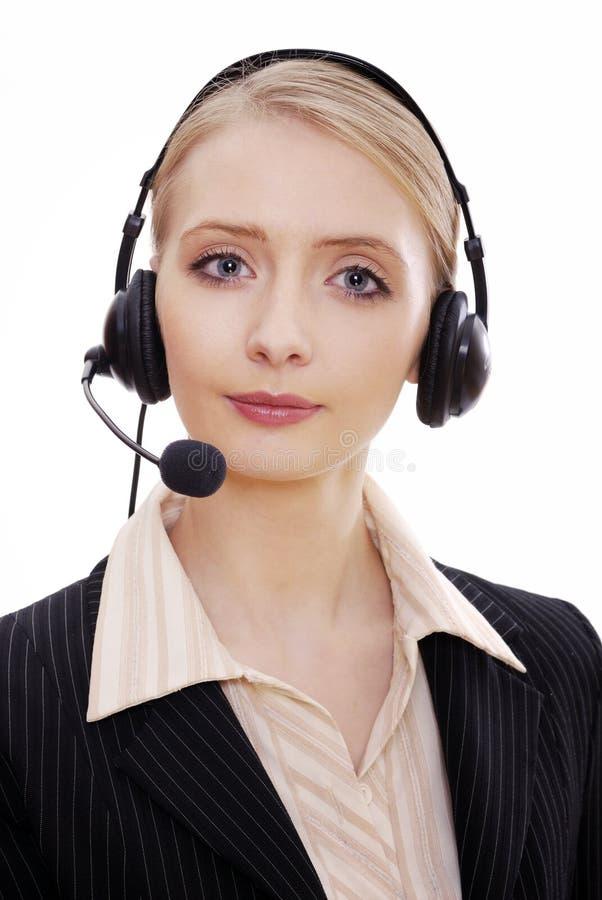Empregado do sexo feminino do centro de chamadas com auriculares imagens de stock royalty free