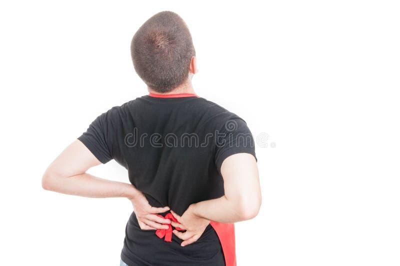 Empregado do sexo masculino cansado que tem a dor lombar fotos de stock royalty free