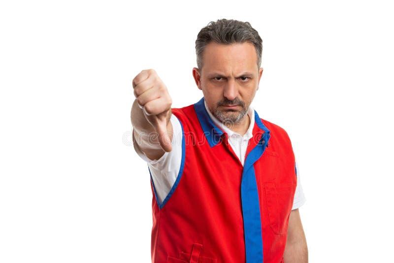 Empregado do supermercado que faz para não gostar do gesto fotos de stock royalty free
