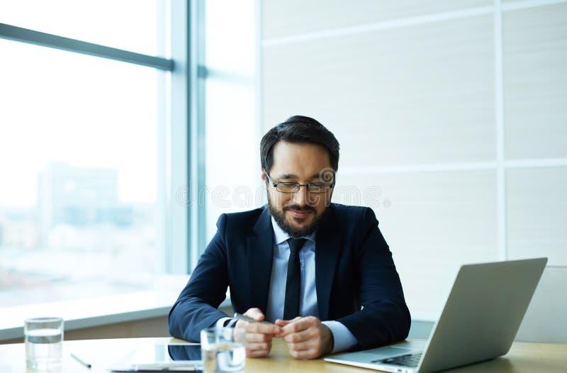 Empregador no escritório imagem de stock royalty free
