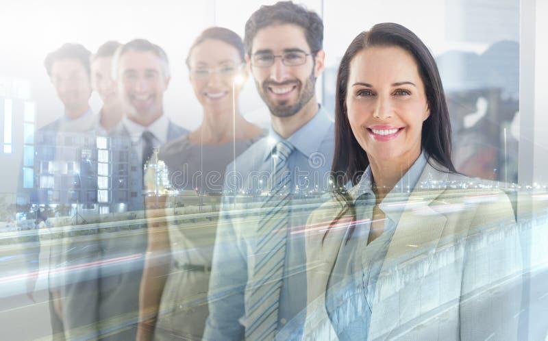 Empregados de sorriso em uma linha imagem de stock royalty free