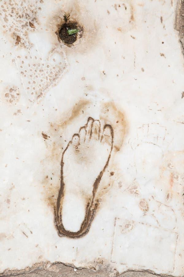 Empreinte de pas sur le marbre pour la publicité du bordel dans Ephesus, photos stock
