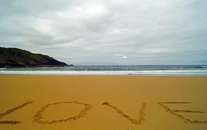 Empreintes de pas dans le sable à la baie de Boyeghether de plage de trou de meurtre photo stock