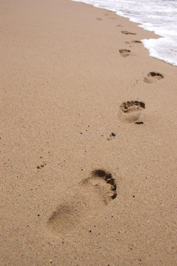 Empreintes de pas en sable photo libre de droits