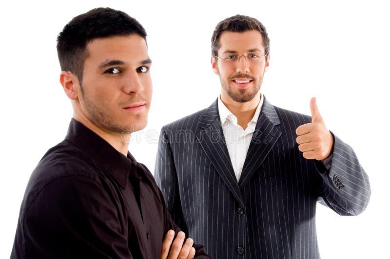 Empresários bem sucedidos com polegares acima fotografia de stock royalty free