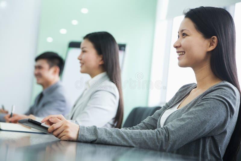 Empresários em uma reunião fotografia de stock