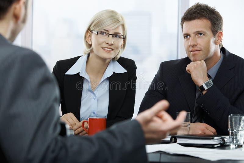 Empresários na reunião fotos de stock royalty free