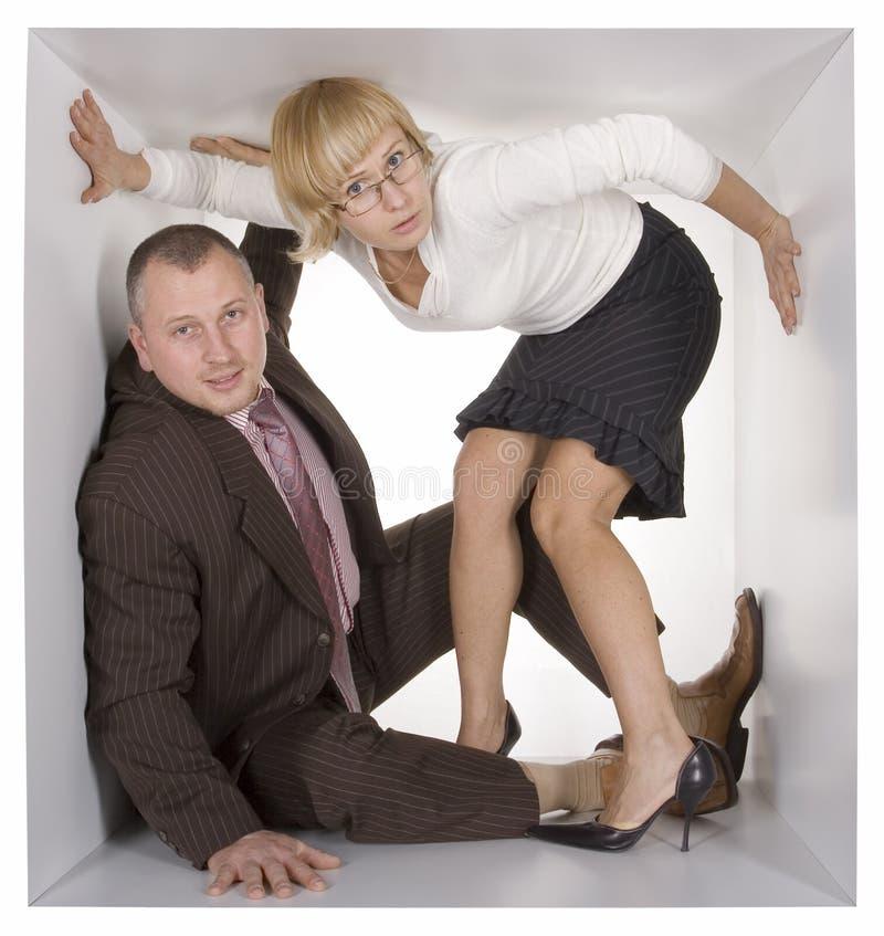 Empresários no cubo fotografia de stock royalty free