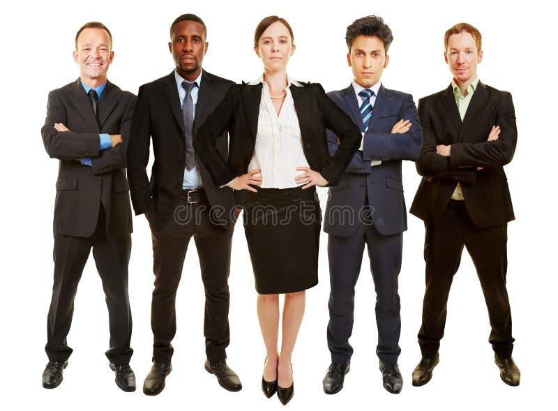 Empresaria como director de gerente con el equipo del negocio fotografía de archivo libre de regalías