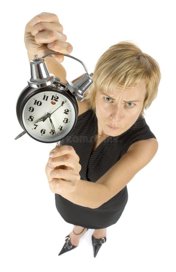 Empresaria con el reloj de alarma fotografía de archivo libre de regalías