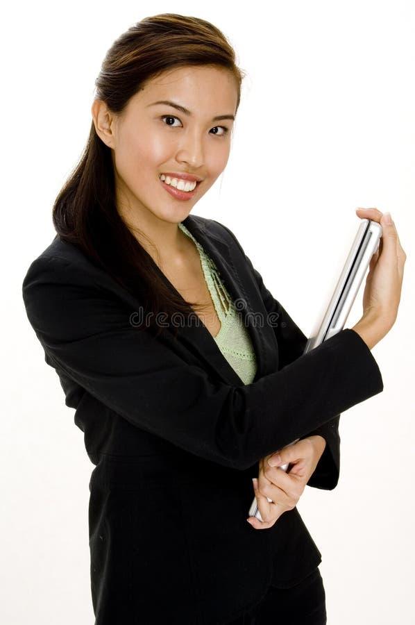 Empresaria con la computadora portátil fotografía de archivo