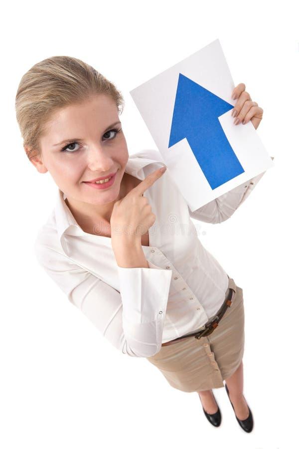 Empresaria con la flecha de la parte superior fotografía de archivo