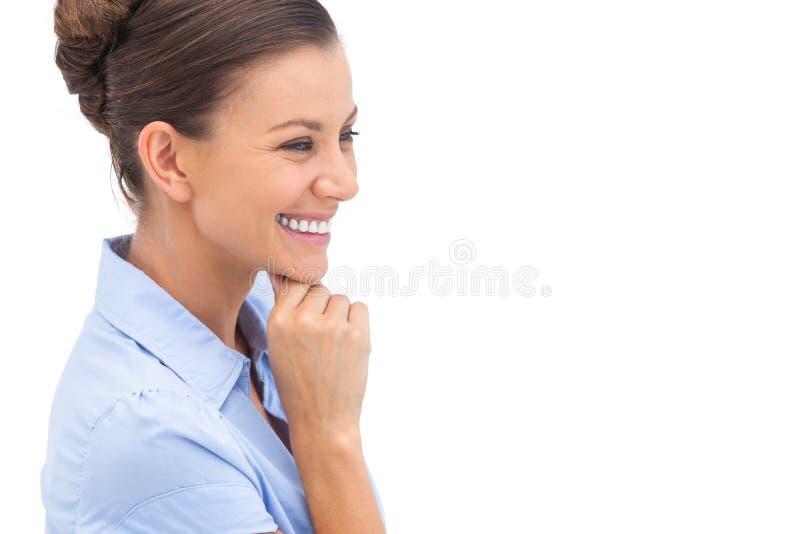 Empresaria de risa con la mano en la barbilla imágenes de archivo libres de regalías