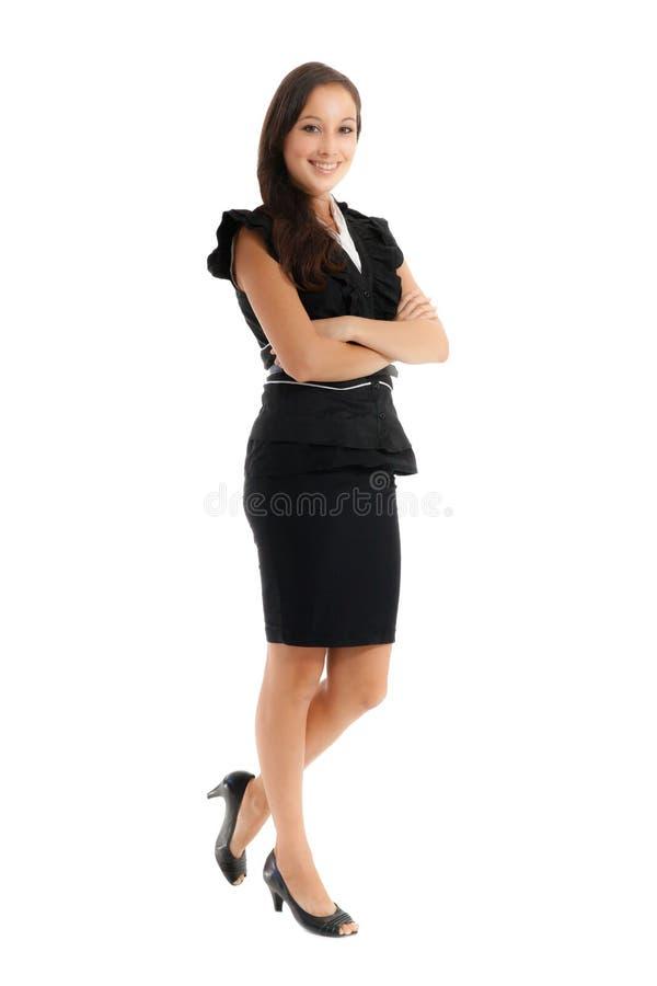 Empresaria de Smilling que se coloca con los brazos cruzados imagenes de archivo