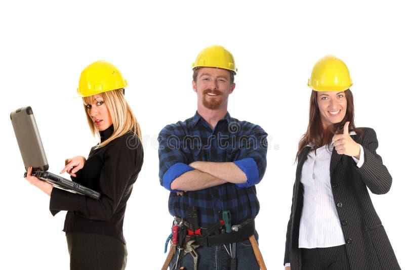 Empresaria dos y trabajador de construcción foto de archivo
